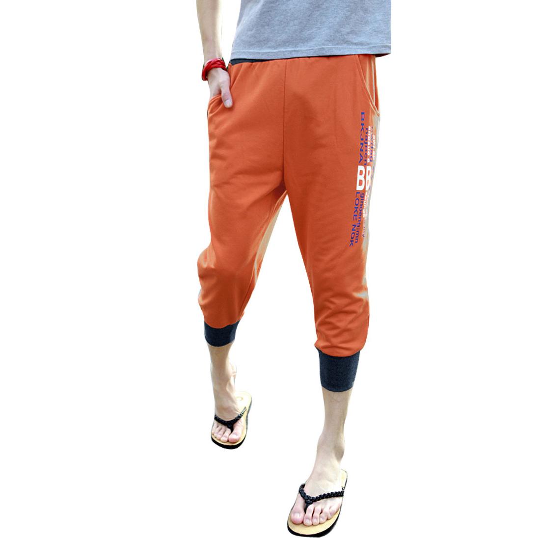Man Fashion Drawstring Waist Design Side Slant Pockets Orange Short Pants W29