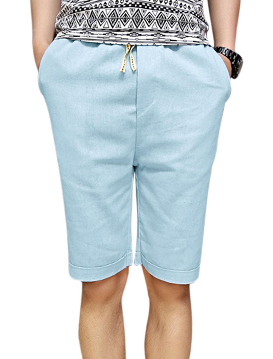 Man's Drawstring Waist Slant Front Pockets Mid Rise Shorts Light Blue W30