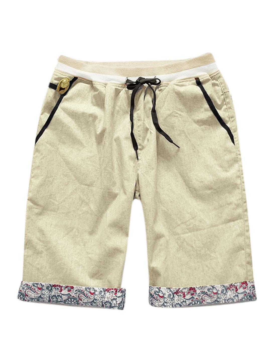 Man Ribbed Elastic Waist Band Slant Pockets Button Decor Casual Shorts Khaki W34